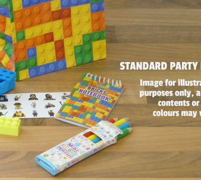 an image of a standard brick party bag in paper includind stickers, brick sharpener, brick rubber, brick notepad, 4 colour pencils and lego themed stickers